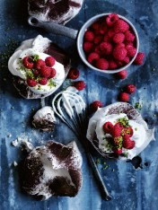 chocolate-dusted pavlovas with raspberries and pistachio