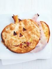 halloween pumpkin-head pizzas